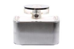 Flacon femelle foncé rectangulaire de parfum sur le blanc Photos libres de droits