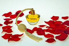 Flacon of perfume in red petals of roses Royalty Free Stock Image