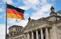 Flag. German national flag in front of Reichstag in Berlin, Germany Stock Image