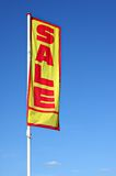 Flag. Colorful SALE flag on a blue background royalty free stock image