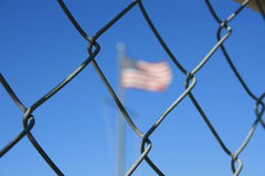 Flag. American flag behind a chain link fence royalty free stock photo