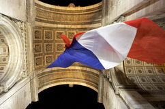 Flag. French flag under the arch of triopmh Royalty Free Stock Images