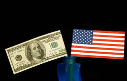 Flag. American money and flag isolated on black background royalty free stock photos