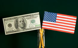 Flag. American money and flag isolated on dark green background royalty free stock photography