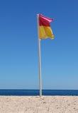 Flag. Life Saver Flag on Beach Royalty Free Stock Image