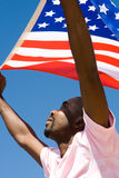 Flag. Young african american man waving with USA flag Royalty Free Stock Photos