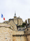Flag and abbey mont saint-michel in Normandy Stock Photography