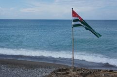 Flag of Abkhazia. On the beach in the city of Gagra Royalty Free Stock Photography