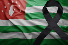Flag of abkhazia with black mourning ribbon. Waving national flag of abkhazia with black mourning ribbon Royalty Free Stock Photography