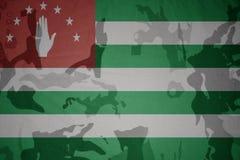 Flag of abkhazia on the khaki texture . military concept. Flag of abkhazia on the khaki texture background. military concept Stock Photography