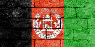 Flag of Afghanistan on old brick wall. Flag of Afghanistan painted over on old brick wall Royalty Free Stock Images
