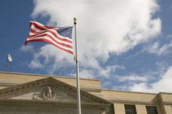 Flag Against Historic Courthouse Stock Images