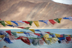 Flag againt blue lake in ladakh. India Stock Photo
