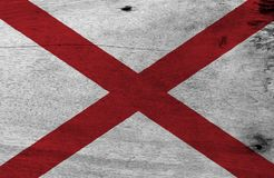 Flag of Alabama on wooden plate background. Grunge Alabama flag texture, The states of America. stock photos