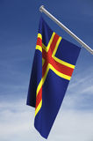 Flag of Aland. Island on a pole royalty free illustration