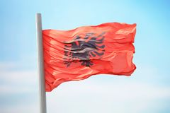 Albanian flag. Flag of Albania against the background of the sky royalty free stock photos