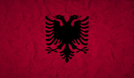Flag of Albania with the effect of crumpled paper and grunge. Flag  of Albania with the effect of crumpled paper and grunge Stock Image