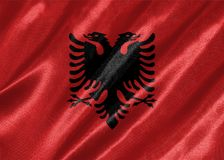 Albania Flag. Waving on satin texture royalty free stock image