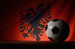 Flag of Albania with football on wooden boards. Stock Photo