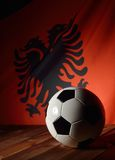 Flag of Albania with football on wooden boards. Stock Images