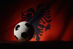 Flag of Albania with football on wooden boards. Stock Photos
