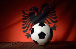 Flag of Albania with football on wooden boards. Stock Photography
