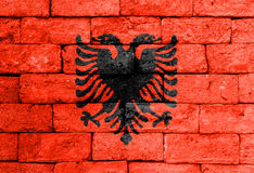 Flag of Albania on old brick wall. Royalty Free Stock Images