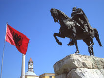 Flag of Albania and statue. The statue of Skanderbeg with the flag of Albania taken in Tirane, Albania Royalty Free Stock Photo