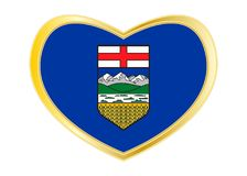 Flag of Alberta in heart shape, golden frame Stock Images