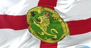 Flag of Alderney waving at wind in slow, loop. Ed stock footage