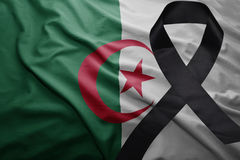 Flag of algeria with black mourning ribbon. Waving national flag of algeria with black mourning ribbon Royalty Free Stock Photography