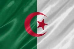Algeria Flag. Waving on satin texture royalty free stock photos