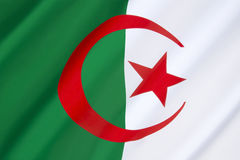 Flag of Algeria. The white represents peace; the green Islam; the red, the blood of those killed fighting for independence in the Algerian War (1954 to 1962) royalty free stock images