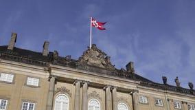 Flag on Amalienborg Palace in Copenhagen stock video
