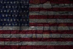 Flag of America on a stone wall stock photo