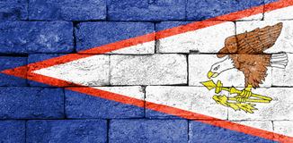 Flag of American Samoa on old brick wall. Stock Photo