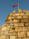 Flag on ancient fortress Stock Photo