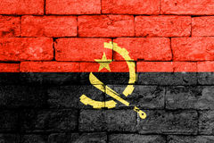 Flag of Angola on old brick wall. Royalty Free Stock Photo