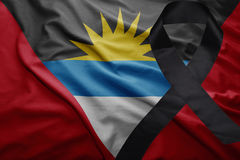 Flag of antigua and barbuda with black mourning ribbon Royalty Free Stock Photos