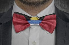 Flag of Antigua Barbuda on bowtie business man suit. Close up royalty free stock photography