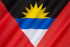Flag of Antigua and Barbuda - Caribbean. The national flag of Antigua and Barbuda was adopted on February 27th 1967. It was designed by a nationally acclaimed royalty free stock photo