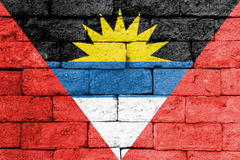 Flag of Antigua and Barbuda on old brick wall. Stock Images