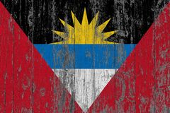 Flag of Antigua and Barbuda painted on worn out wooden texture background.  stock photography