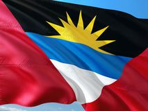 Flag of Antigua and Barbuda waving in the wind against deep blue sky. High quality fabric.  stock images