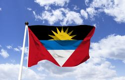 Flag of Antigua and Barbuda. The Yellow Sun that symbolizes the birth of a new era. Black is connected to the night sky. The Caribbean Sea blue, White the stock images