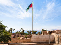 Flag of Arab Revolt over Mamluk Castle in Aqaba Royalty Free Stock Photography