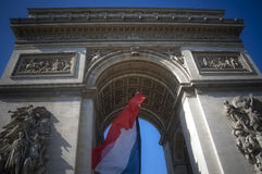 Flag Arc de Triomphe. Famous monument Arc de Triomphe in Paris with the French Flag flying in the middle Stock Photos