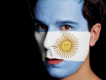 Flag of Argentina. Painted on a Face of a Young Man Stock Image