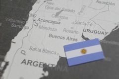 The flag of Argentina placed on Buenos Aires map of world map stock images
