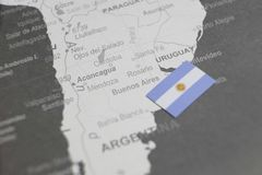 The flag of Argentina placed on Buenos Aires map of world map stock photography
